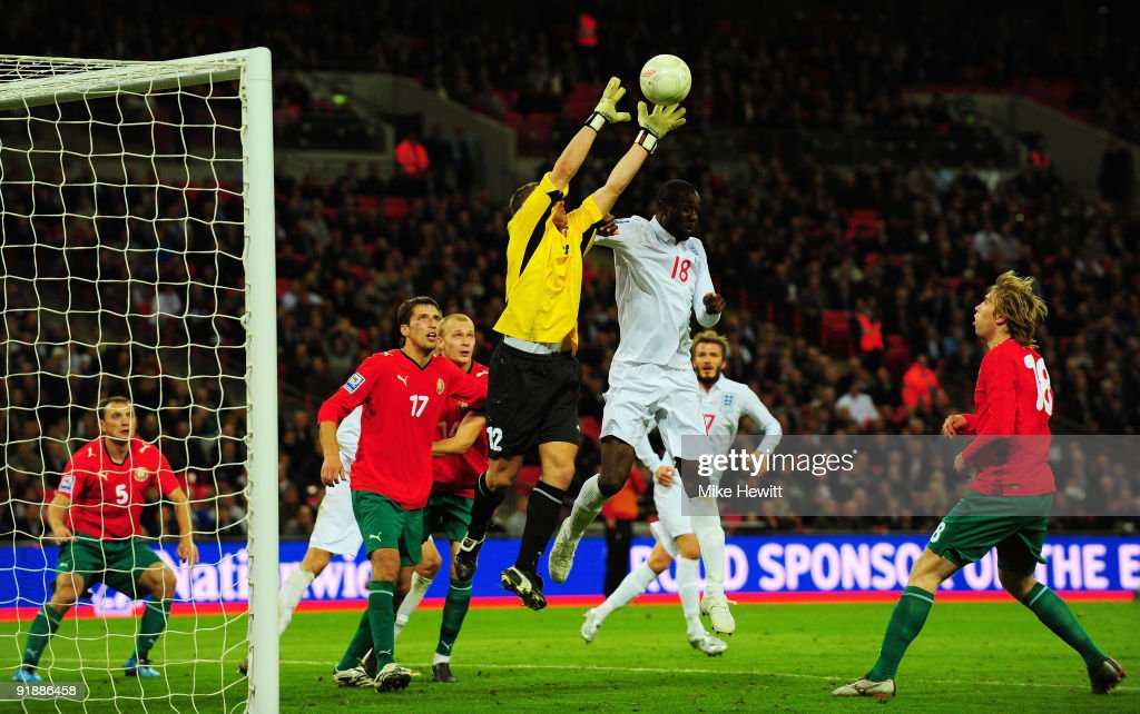 <a gi-track='captionPersonalityLinkClicked' href=/galleries/search?phrase=Carlton+Cole&family=editorial&specificpeople=215313 ng-click='$event.stopPropagation()'>Carlton Cole</a> of England challenges goalkeeper Yuri Zhevnov of Belarus during the FIFA 2010 World Cup Qualifying Group 6 match between England and Belarus at Wembley Stadium on October 14, 2009 in London, England.