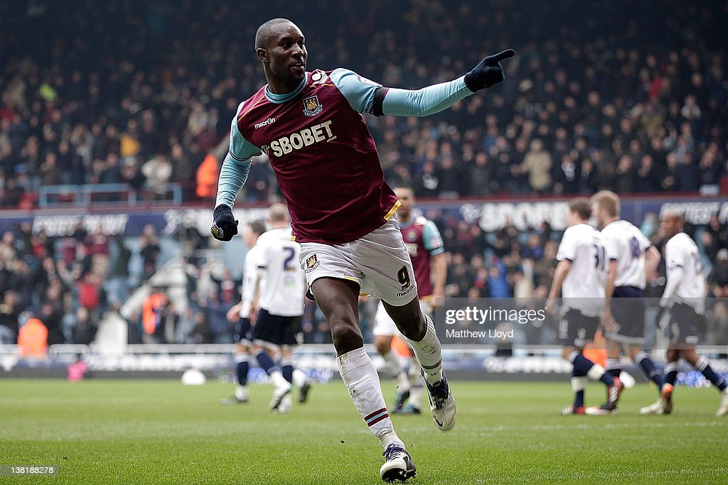 <a gi-track='captionPersonalityLinkClicked' href=/galleries/search?phrase=Carlton+Cole&family=editorial&specificpeople=215313 ng-click='$event.stopPropagation()'>Carlton Cole</a> of West Ham celebrates after scoring the opening goal during the npower Championship match between West Ham United and Millwall, at Boleyn Ground on February 04, 2012 in London, England.