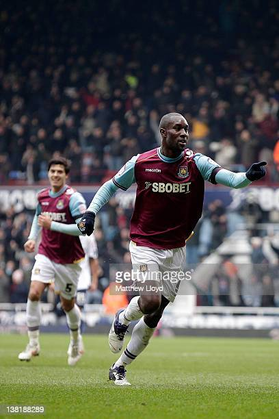 Carlton Cole of West Ham celebrates after scoring the opening goal during the npower Championship match between West Ham United and Millwall at...