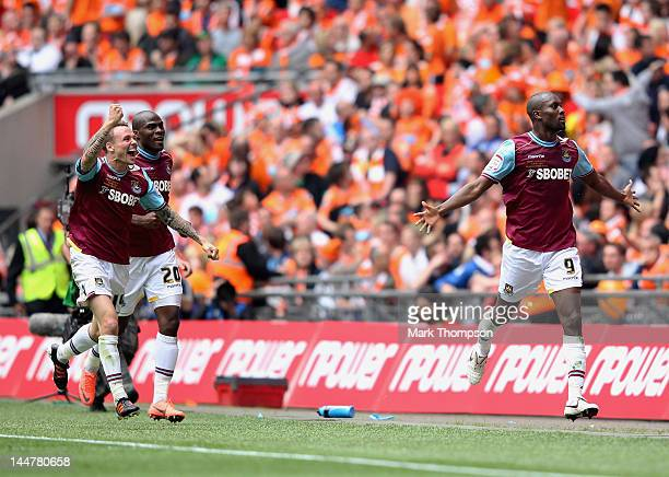 Carlton Cole of West Ham celebrates his goal with team mates during the npower Championship Playoff Final between West Ham United and Blackpool at...