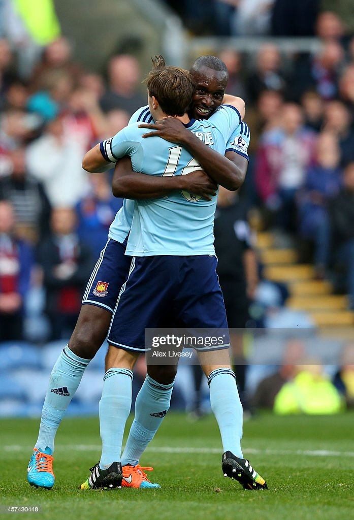 <a gi-track='captionPersonalityLinkClicked' href=/galleries/search?phrase=Carlton+Cole&family=editorial&specificpeople=215313 ng-click='$event.stopPropagation()'>Carlton Cole</a> of West Ham is congratulated by teammate <a gi-track='captionPersonalityLinkClicked' href=/galleries/search?phrase=Mark+Noble&family=editorial&specificpeople=844055 ng-click='$event.stopPropagation()'>Mark Noble</a> after scoring his team's third goal during the Barclays Premier League match between Burnley and West Ham United at Turf Moor on October 18, 2014 in Burnley, England.