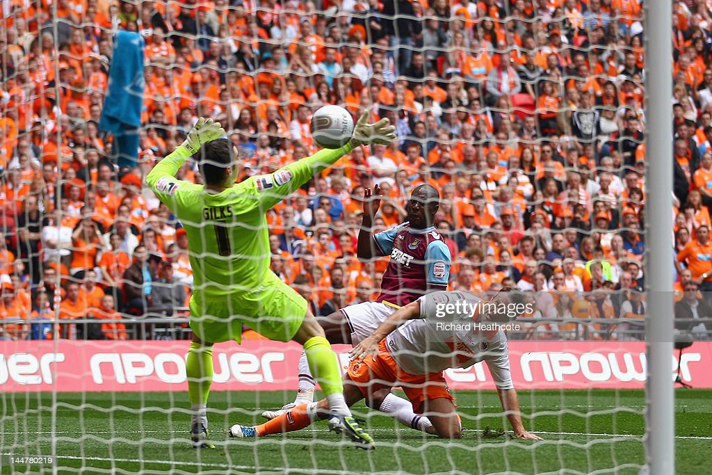 Carlton Cole of West Ham scores the opening goal during the npower Championship Playoff Final between West Ham United and Blackpool at Wembley Stadium on May 19, 2012 in London, England.