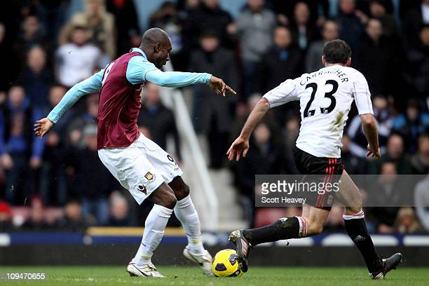 Carlton Cole of West Ham shoots to score their third goal during the Barclays Premier League match between West Ham United and Liverpool at the...