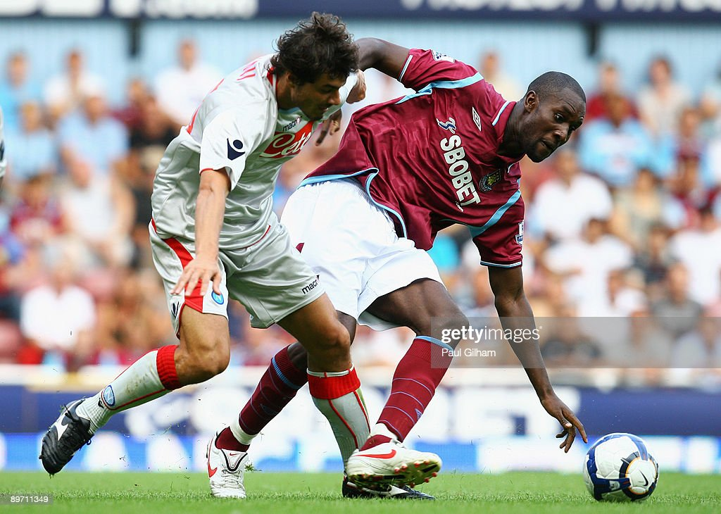 Carlton Cole of West Ham United battles for the ball with Matteo Contini of Napoli during the Bobby Moore Cup between West Ham United and Napoli at...
