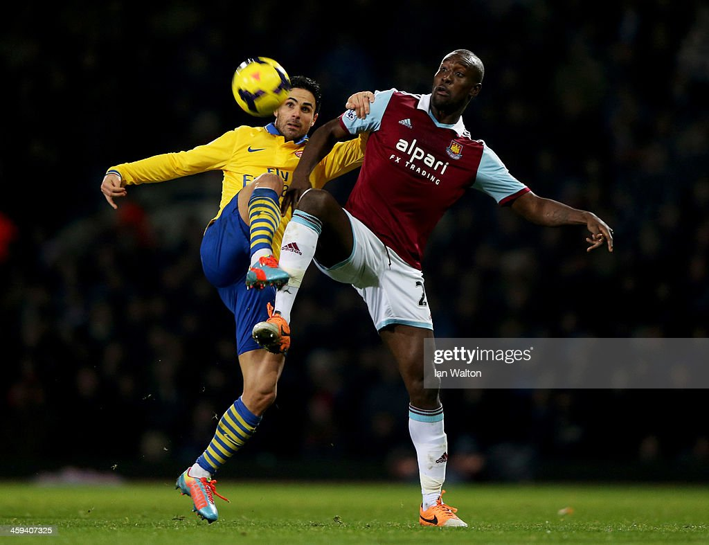 <a gi-track='captionPersonalityLinkClicked' href=/galleries/search?phrase=Carlton+Cole&family=editorial&specificpeople=215313 ng-click='$event.stopPropagation()'>Carlton Cole</a> of West Ham United battles with <a gi-track='captionPersonalityLinkClicked' href=/galleries/search?phrase=Mikel+Arteta&family=editorial&specificpeople=235322 ng-click='$event.stopPropagation()'>Mikel Arteta</a> of Arsenal during the Barclays Premier League match between West Ham United and Arsenal at Boleyn Ground on December 26, 2013 in London, England.
