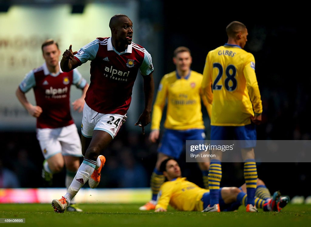 <a gi-track='captionPersonalityLinkClicked' href=/galleries/search?phrase=Carlton+Cole&family=editorial&specificpeople=215313 ng-click='$event.stopPropagation()'>Carlton Cole</a> of West Ham United (24) celebrates as he scores their first goal during the Barclays Premier League match between West Ham United and Arsenal at Boleyn Ground on December 26, 2013 in London, England.