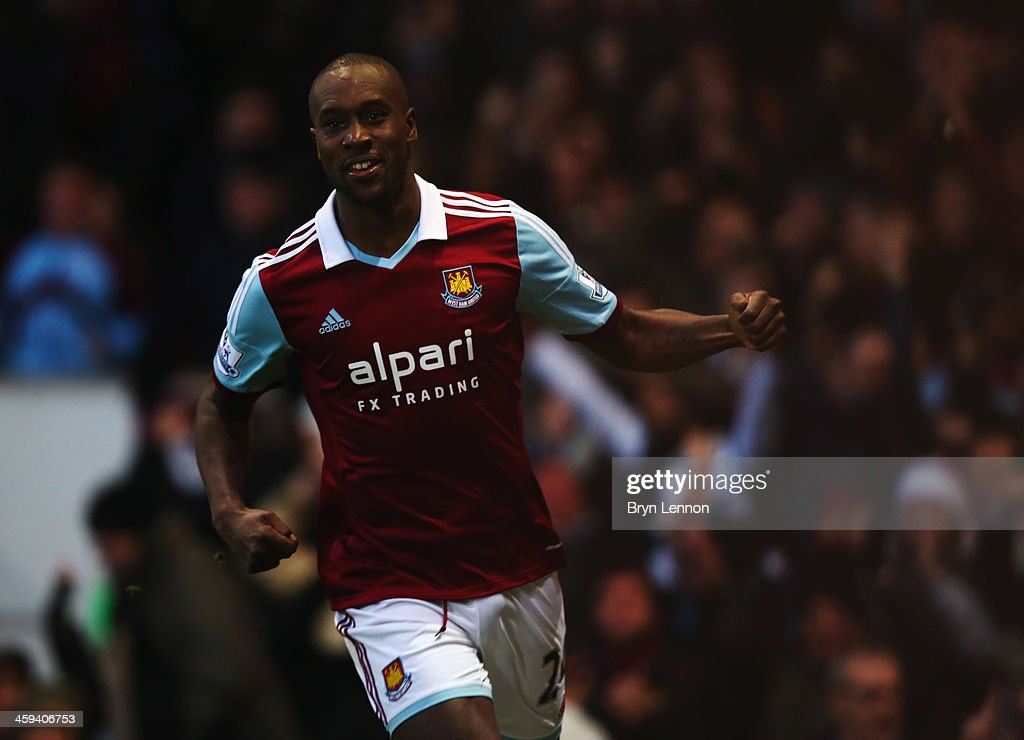 <a gi-track='captionPersonalityLinkClicked' href=/galleries/search?phrase=Carlton+Cole&family=editorial&specificpeople=215313 ng-click='$event.stopPropagation()'>Carlton Cole</a> of West Ham United celebrates as he scores their first goal during the Barclays Premier League match between West Ham United and Arsenal at Boleyn Ground on December 26, 2013 in London, England.