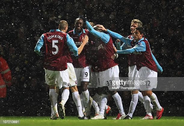 Carlton Cole of West Ham United celebrates West Ham's third goal with team mates during the Carling Cup Quarter Final match between West Ham United...