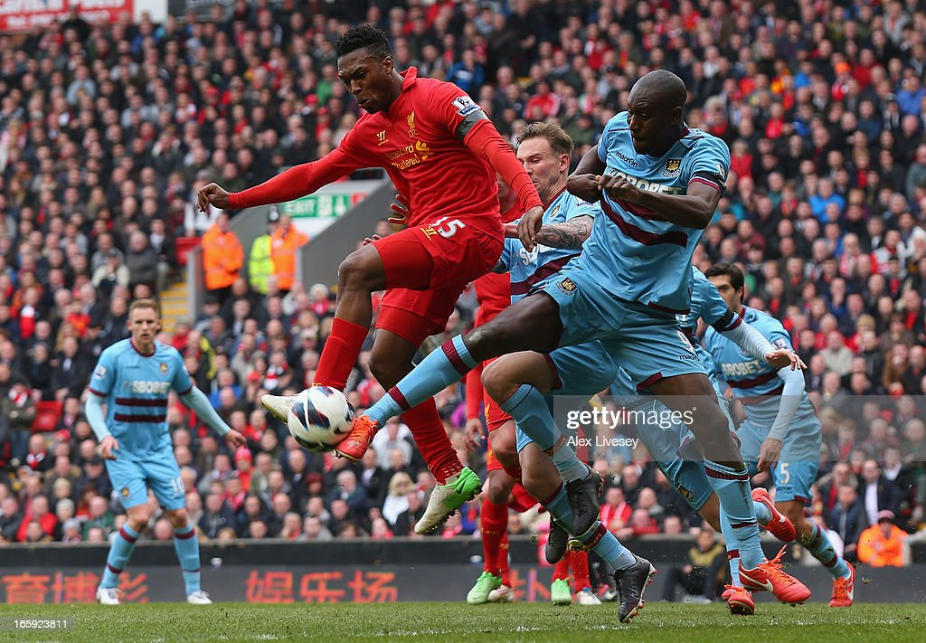 Carlton Cole of West Ham United challenges Daniel Sturridge of Liverpool during the Barclays Premier League match between Liverpool and West Ham United at Anfield on April 7, 2013 in Liverpool, England.