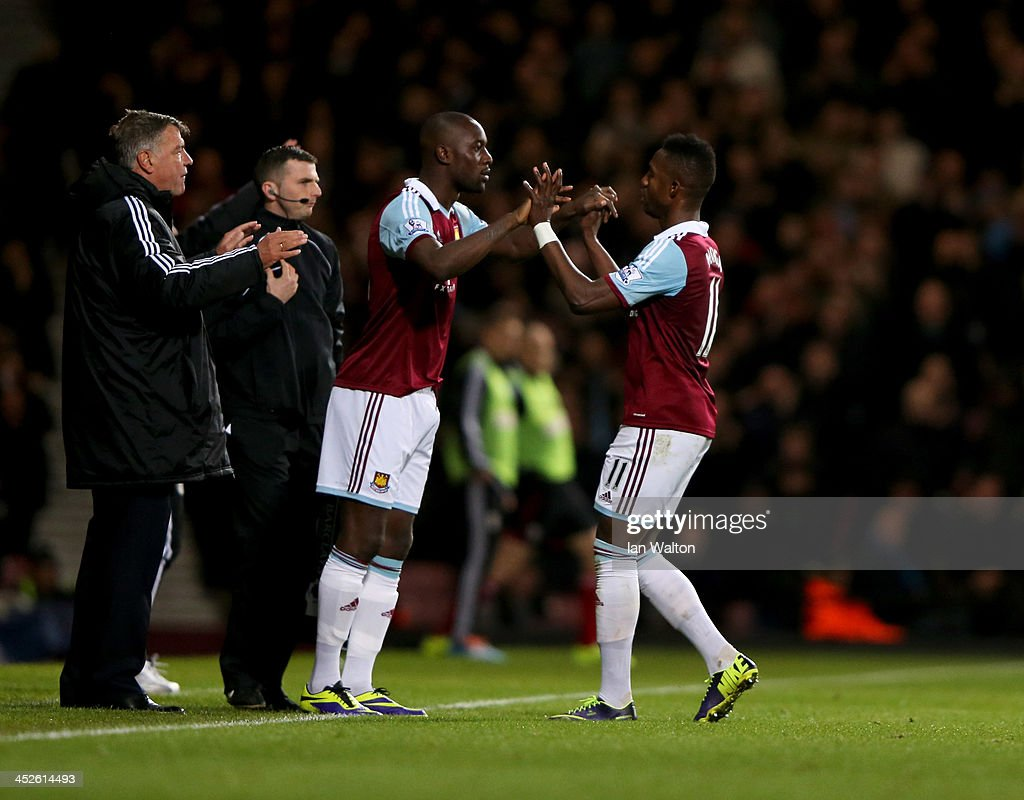 <a gi-track='captionPersonalityLinkClicked' href=/galleries/search?phrase=Carlton+Cole&family=editorial&specificpeople=215313 ng-click='$event.stopPropagation()'>Carlton Cole</a> of West Ham United replaces Modibo Maiga of West Ham United as as a substitute during the Barclays Premier League match between West Ham United and Fulham at Boleyn Ground on November 30, 2013 in London, England.