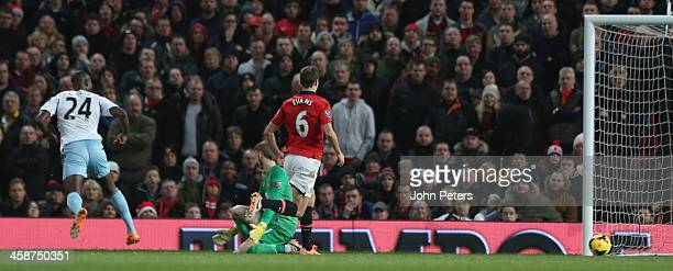 Carlton Cole of West Ham United scores their first goal during the Barclays Premier League match between Manchester United and West Ham United at Old...