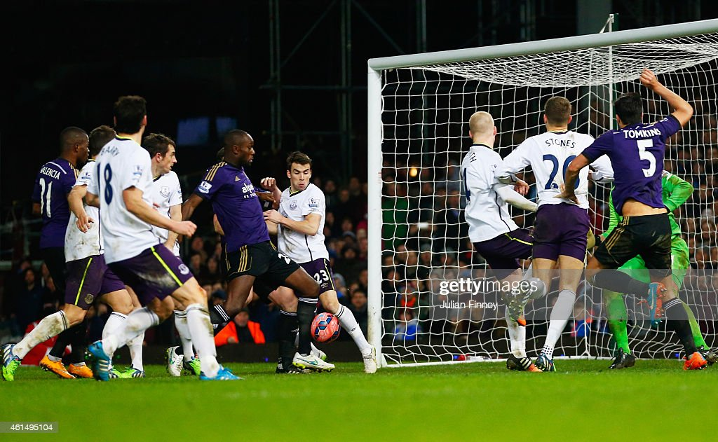<a gi-track='captionPersonalityLinkClicked' href=/galleries/search?phrase=Carlton+Cole&family=editorial&specificpeople=215313 ng-click='$event.stopPropagation()'>Carlton Cole</a> of West Ham United (C) scores their second goal during the FA Cup Third Round Replay match between West Ham United and Everton at Boleyn Ground on January 13, 2015 in London, England.