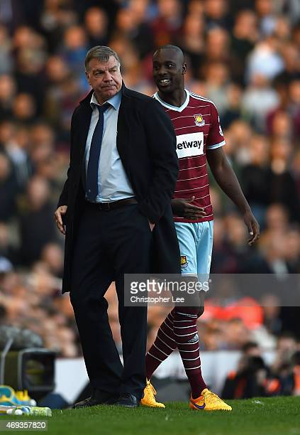 Carlton Cole of West Ham United smiles as he is brought on as a substitute by Manager Sam Allardyce during the Barclays Premier League match between...