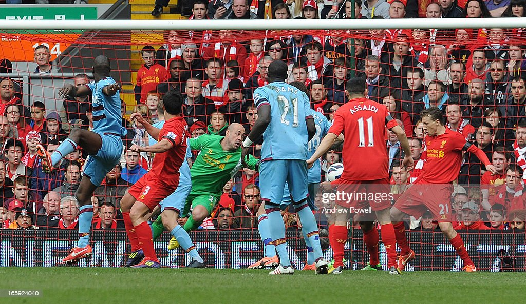 Carlton Cole of West Ham United (L) tries a shot at goal during the Barclays Premier League match between Liverpool and West Ham United at Anfield on April 7, 2013 in Liverpool, England.