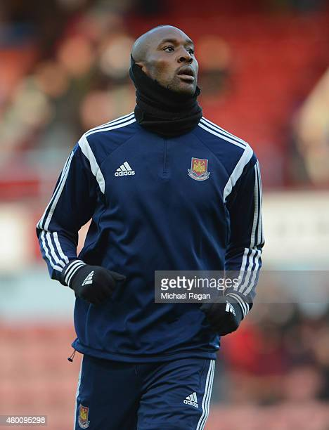 Carlton Cole of West Ham warms up prior to the Barclays Premier League match between West Ham United and Swansea City at Boleyn Ground on December 7...