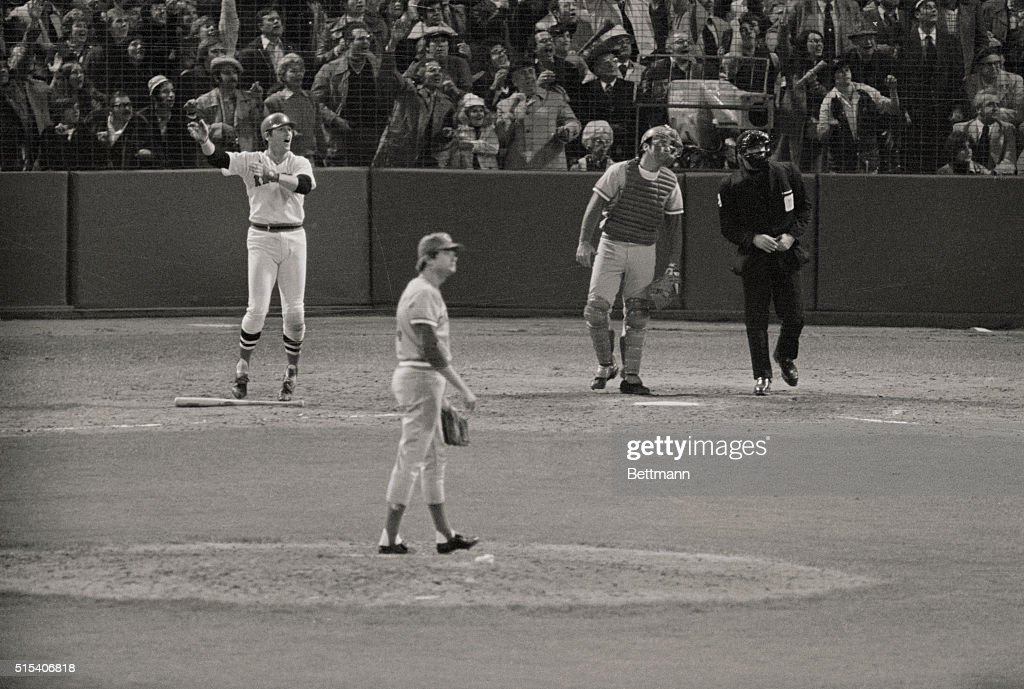 Carlton Fisk hits the ball in the 12th inning for a home run, winning the game 7-6 and tieing the series 3-3.