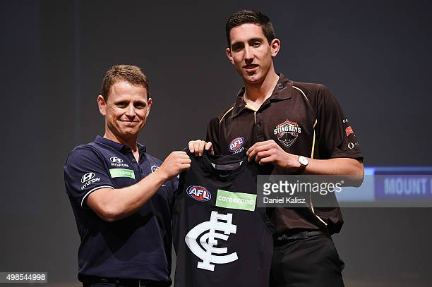 Carlton Football Club head coach Brendon Bolton with the number one draft pick Jacob Weitering of the Carlton Football Club during the 2015 AFL Draft...