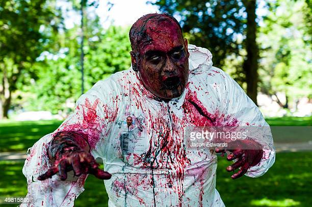 A hospital research technician zombie in a blood-soaked bio hazard suit.