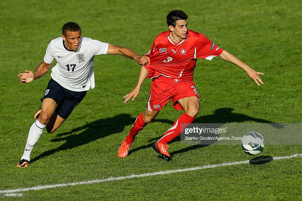 Carlton Morris of England and Thomas Fraga of Switzerland during the UEFA U19 Championships Qualifier between England and Switzerland, on October 15, 2013 in Ptuj, Slovenia.