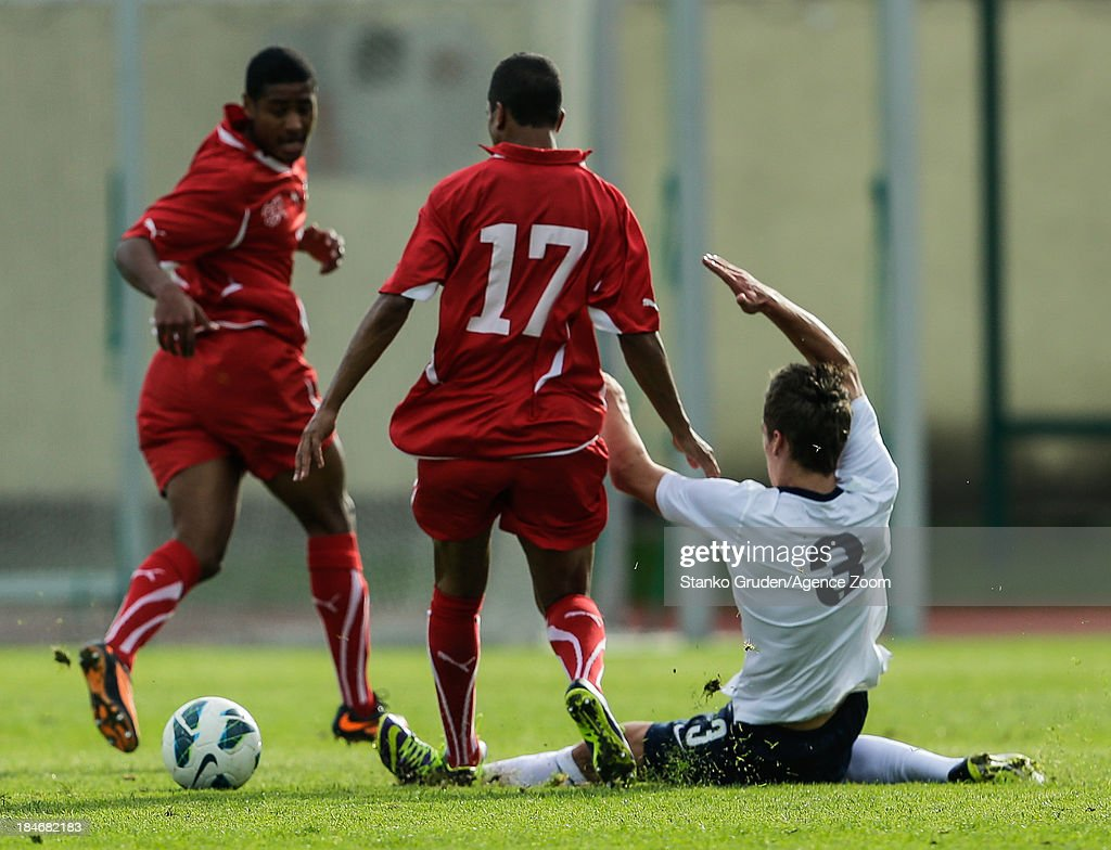Carlton Morris of England and Thomas Fraga of Switzerland in action during the UEFA U19 Championships Qualifier between England and Switzerland, on October 15, 2013 in Ptuj, Slovenia.