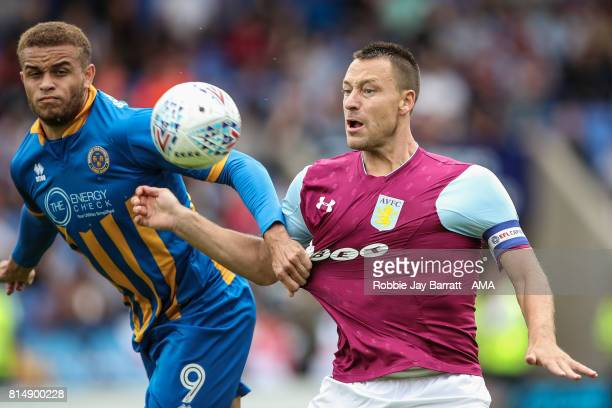 Carlton Morris of Shrewsbury Town and John Terry of Aston Villa during the preseason friendly match between Shrewsbury Town and Aston Villa at...