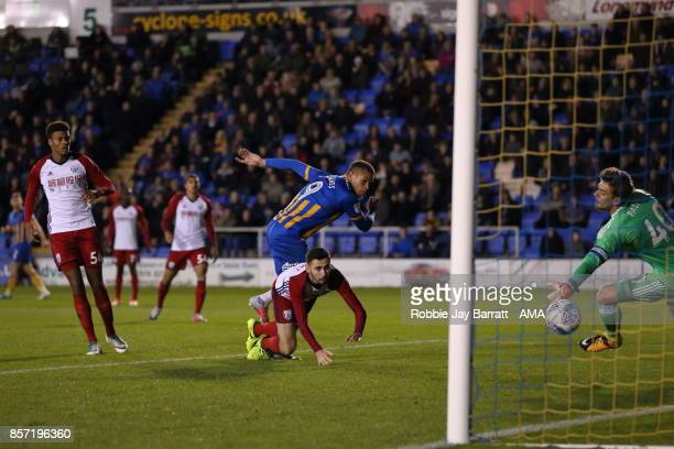 Carlton Morris of Shrewsbury Town scores a goal to make it 20 during the EFL Checkatrade Trophy Northern Section Group B game between Shrewsbury Town...