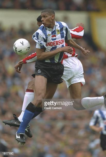 Carlton Palmer of Sheffield Wednesday and Brian Deane of Sheffield United jump for the ball during the FA Cup semifinal against Sheffield United at...