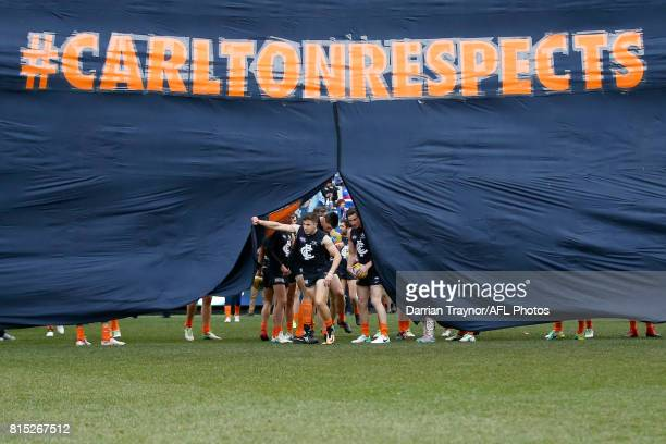Carlton players run through the banner before the round 17 AFL match between the Carlton Blues and the Western Bulldogs at Melbourne Cricket Ground...