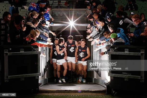 Carlton players walk up the race after the half time break during the round 19 AFL match between the Collingwood Magpies and Carlton Blues at...