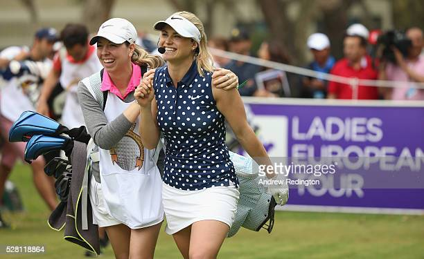 Carly Booth of Scotland and her caddie share a joke during a mixed exhibition match prior to the start of the Trophee Hassan II at Royal Golf Dar Es...