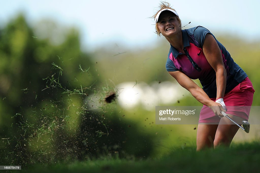 Carly Booth of Scotland hits out of the rough on the 15th hole during the Australian Ladies Masters at Royal Pines Resort on February 3, 2013 on the Gold Coast, Australia.