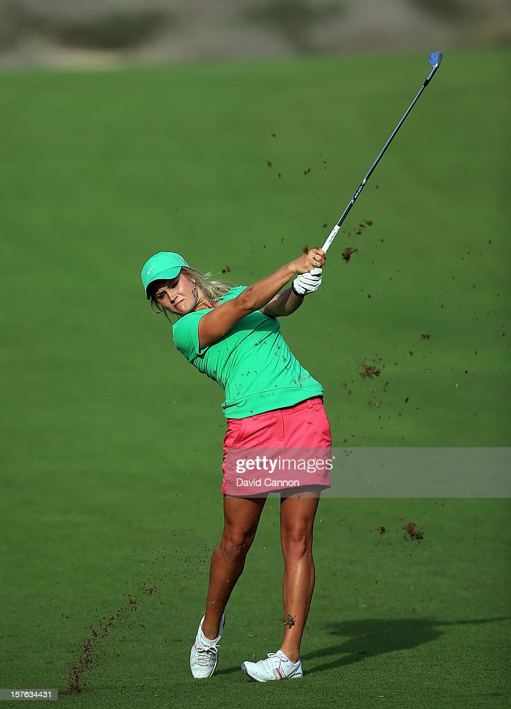 Carly Booth of Scotland plays her second shot at the par 4, 14th hole during the first round of the 2012 Omega Dubai Ladies Masters on the Majilis Course at the Emirates Golf Club on December 5, 2012 in Dubai, United Arab Emirates.