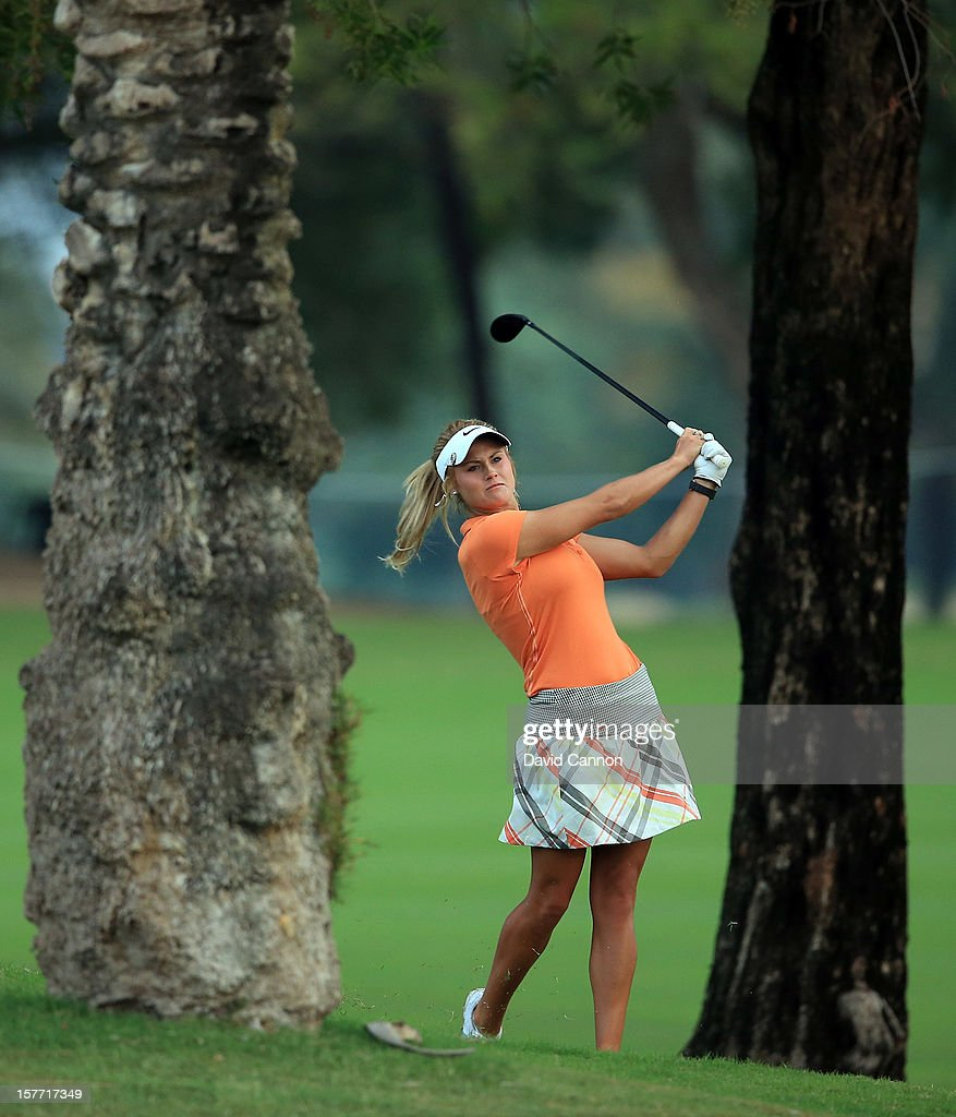 Carly Booth of Scotland plays her second shot at the par 5, 10th hole during the second round of the 2012 Omega Dubai Ladies Masters on the Majilis Course at the Emirates Golf Club on December 6, 2012 in Dubai, United Arab Emirates.