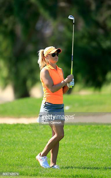 Carly Booth of Scotland plays her second shot on the par 4 first hole during the second round of the 2015 Omega Dubai Ladies Masters on the Majlis...