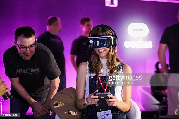 Carly Chevalier of VR Scout tries out the Samsung Gear VR headset a mobile virtual reality device while experiencing Minecraft for Gear VR during a...
