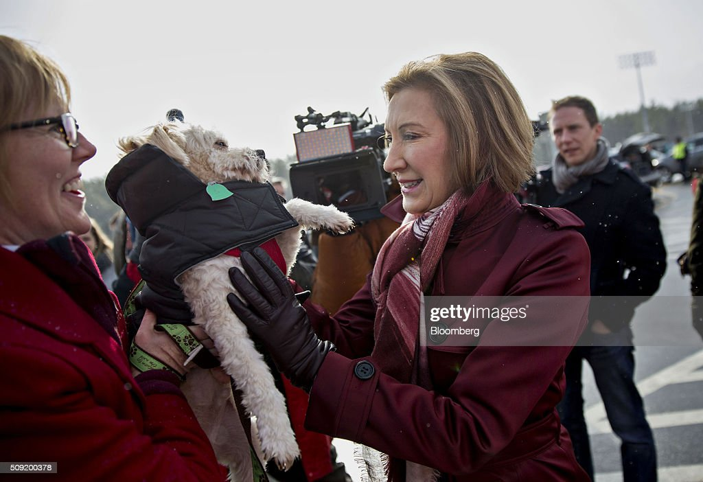 Carly Fiorina, former chairman and chief executive officer of Hewlett-Packard Co. and 2016 Republican presidential candidate, right, greets a woman and her dog while arriving at a polling station in Bedford, New Hampshire, U.S., on Tuesday, Feb. 9, 2016. Voters in New Hampshire took to the polls today in the nation's first primary in the U.S. presidential race. Photographer: Daniel Acker/Bloomberg via Getty Images