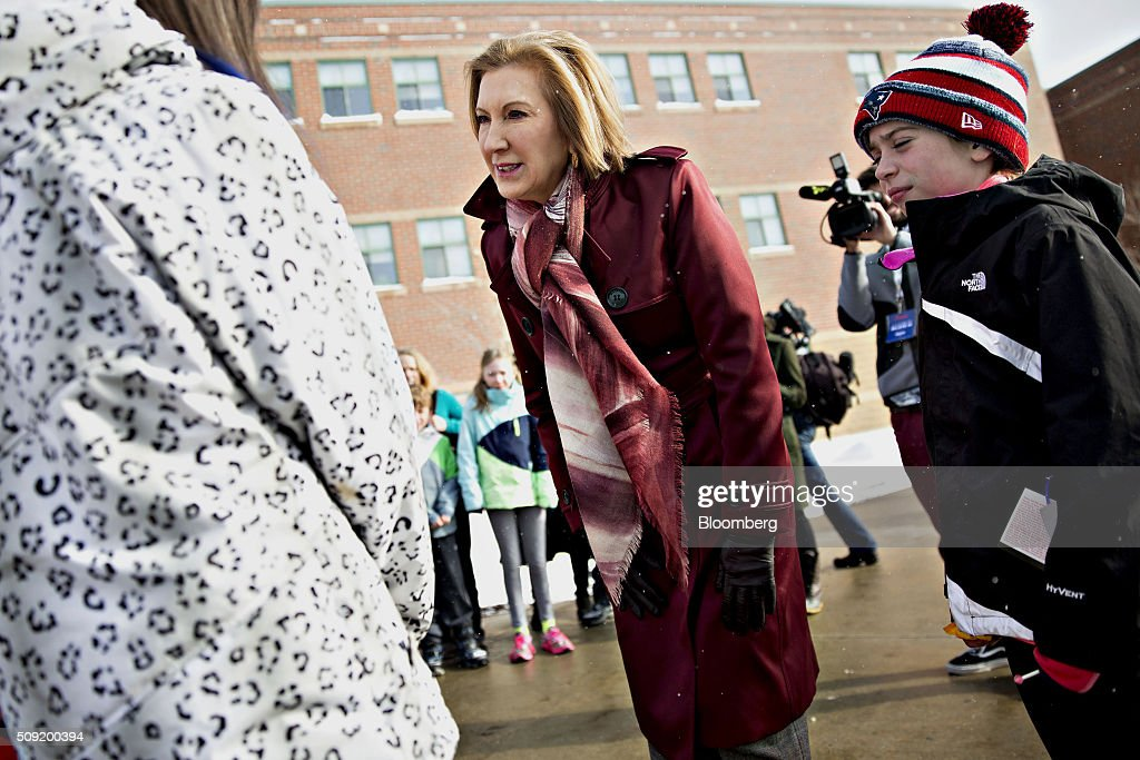 Carly Fiorina, former chairman and chief executive officer of Hewlett-Packard Co. and 2016 Republican presidential candidate, center, greets residents at a polling station in Bedford, New Hampshire, U.S., on Tuesday, Feb. 9, 2016. Voters in New Hampshire took to the polls today in the nation's first primary in the U.S. presidential race. Photographer: Daniel Acker/Bloomberg via Getty Images