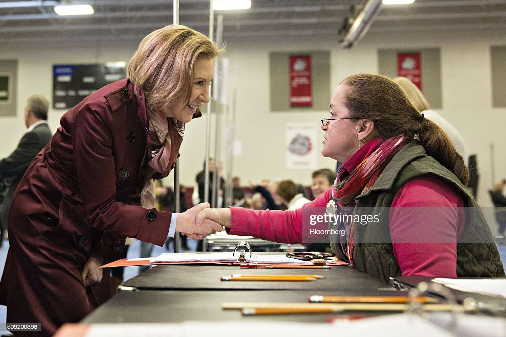 Carly Fiorina, former chairman and chief executive officer of Hewlett-Packard Co. and 2016 Republican presidential candidate, left, greets a poll worker inside a polling station in Bedford, New Hampshire, U.S., on Tuesday, Feb. 9, 2016. Voters in New Hampshire took to the polls today in the nation's first primary in the U.S. presidential race. Photographer: Daniel Acker/Bloomberg via Getty Images