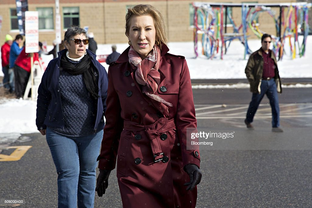 Carly Fiorina, former chairman and chief executive officer of Hewlett-Packard Co. and 2016 Republican presidential candidate, center, walks outside after visiting a polling station in Bedford, New Hampshire, U.S., on Tuesday, Feb. 9, 2016. Voters in New Hampshire took to the polls today in the nation's first primary in the U.S. presidential race. Photographer: Daniel Acker/Bloomberg via Getty Images
