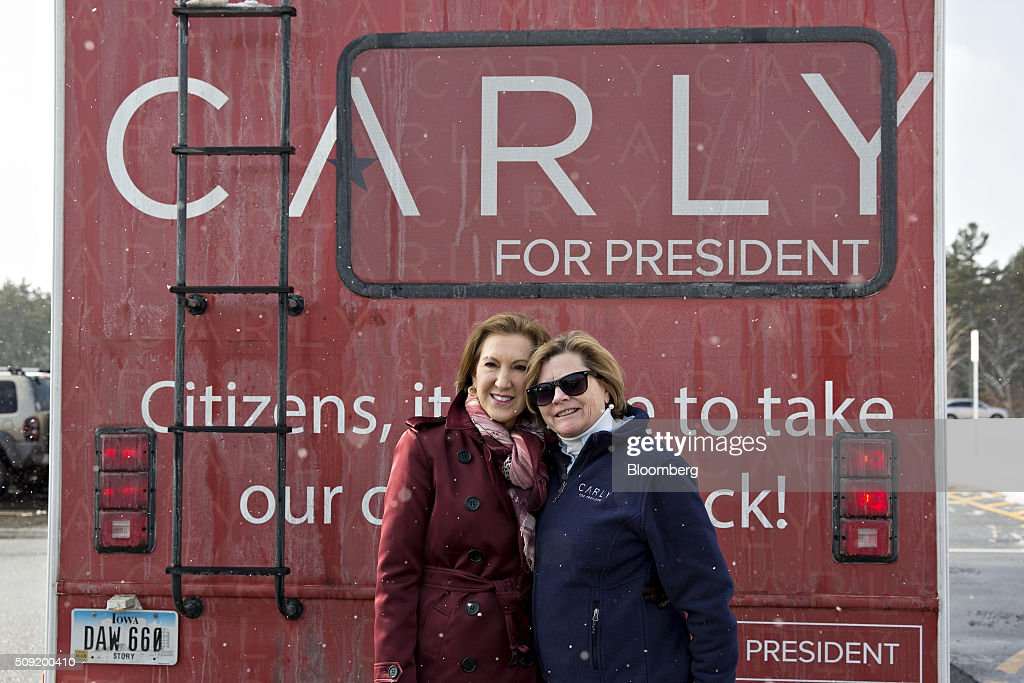 Carly Fiorina, former chairman and chief executive officer of Hewlett-Packard Co. and 2016 Republican presidential candidate, left, stands for a photograph behind her campaign RV after visiting a polling station in Bedford, New Hampshire, U.S., on Tuesday, Feb. 9, 2016. Voters in New Hampshire took to the polls today in the nation's first primary in the U.S. presidential race. Photographer: Daniel Acker/Bloomberg via Getty Images
