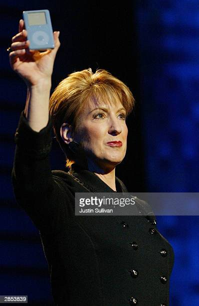 Carly Fiorina holds up an iPod as she delivers a keynote address at the International Consumer Electronics Show January 8 2004 in Las Vegas Fiorina...