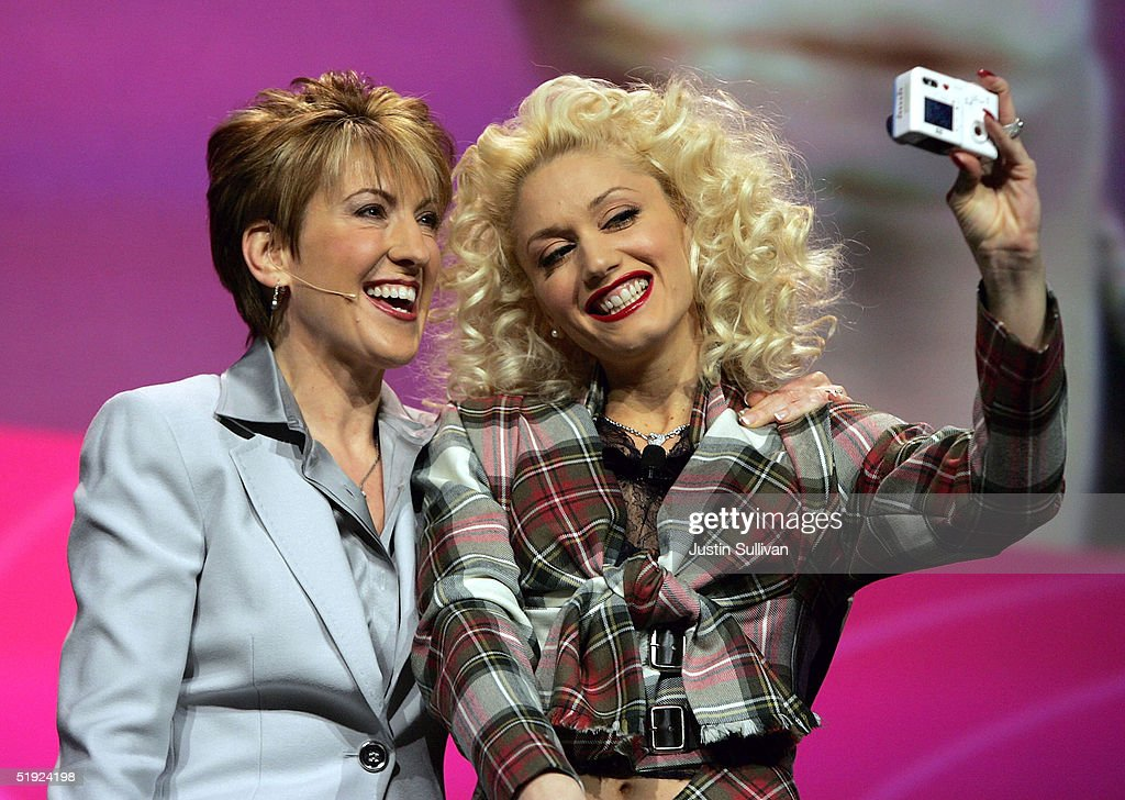<a gi-track='captionPersonalityLinkClicked' href=/galleries/search?phrase=Carly+Fiorina&family=editorial&specificpeople=207075 ng-click='$event.stopPropagation()'>Carly Fiorina</a> takes a photo with musician <a gi-track='captionPersonalityLinkClicked' href=/galleries/search?phrase=Gwen+Stefani&family=editorial&specificpeople=156423 ng-click='$event.stopPropagation()'>Gwen Stefani</a> during Fiorina's keynote address at the 2005 Consumer Electronics Show January 7, 2005 in Las Vegas, Nevada. The 1.5 million square foot electornic gadget show runs through January 9 and is expected to attract over 120,000 attendees.
