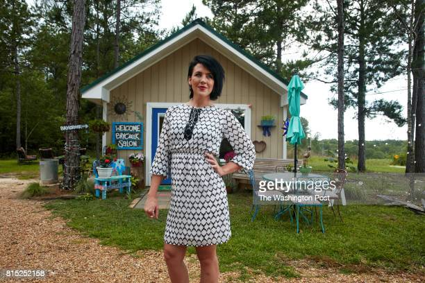 Carly McKenzie wears an Ivanka Trump dress in Lumberton Mississippi on June 10 2017 McKenzie is standing in front of her business Bay Creek Salon to...