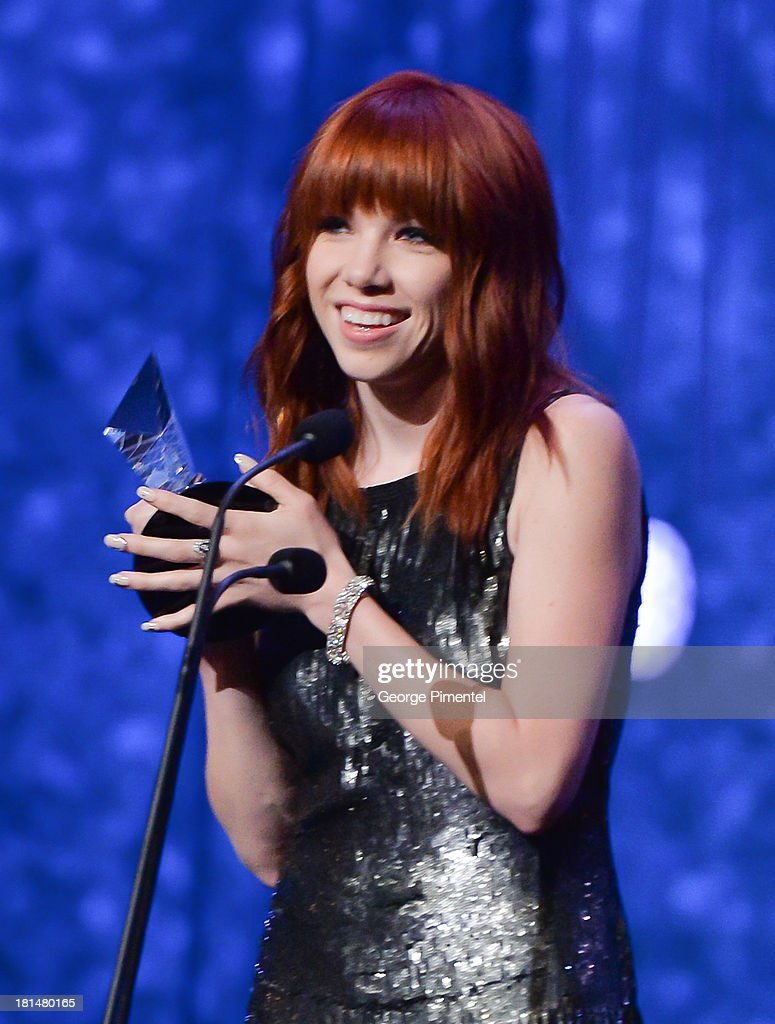 <a gi-track='captionPersonalityLinkClicked' href=/galleries/search?phrase=Carly+Rae+Jepsen&family=editorial&specificpeople=6903584 ng-click='$event.stopPropagation()'>Carly Rae Jepsen</a> accepts the 2013 Allan Slaight Award at Canada's Walk Of Fame Ceremony at The Elgin on September 21, 2013 in Toronto, Canada.