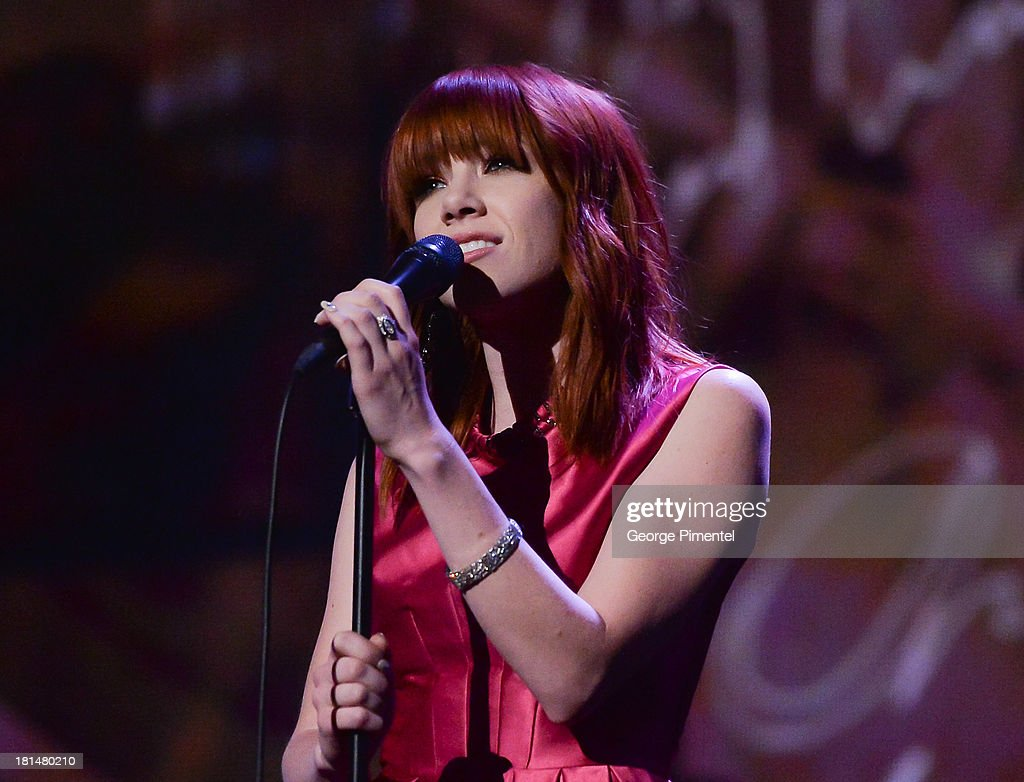 <a gi-track='captionPersonalityLinkClicked' href=/galleries/search?phrase=Carly+Rae+Jepsen&family=editorial&specificpeople=6903584 ng-click='$event.stopPropagation()'>Carly Rae Jepsen</a> performs at Canada's Walk Of Fame Ceremony at The Elgin on September 21, 2013 in Toronto, Canada.