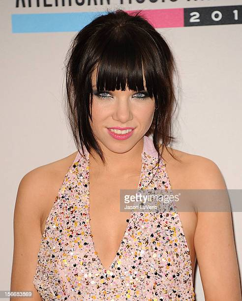 Carly Rae Jepsen poses in the press room at the 40th American Music Awards at Nokia Theatre LA Live on November 18 2012 in Los Angeles California
