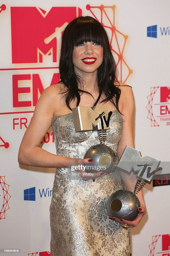 Carly Rae Jepsen poses with her awards for the Best Song, 'Call me, maybe' and Best Push backstage in the photo room the MTV EMA's 2012 at Festhalle Frankfurt on November 11, 2012 in Frankfurt am Main, Germany.