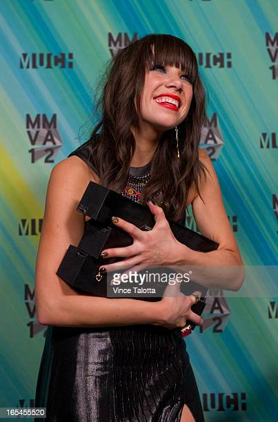 Carly Rae Jepsen poses with her three award for photographers at 2012 MMVAs Sunday June 17 2012 TARA WALTON/TORONTO STAR