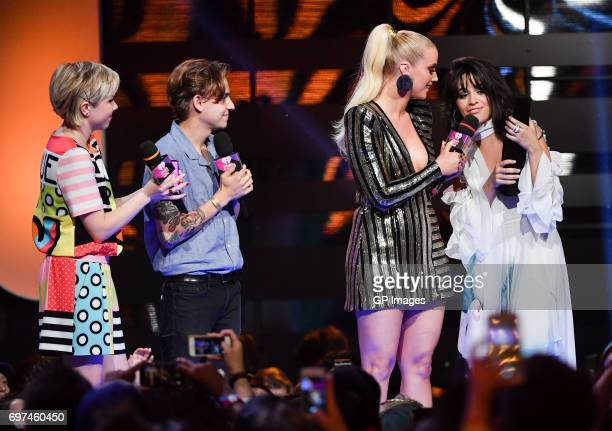 Carly Rae Jepsen Scott Helman and Liz Trinnear present the award for Best New International Artist to Camilla Cabello at the 2017 iHeartRADIO...