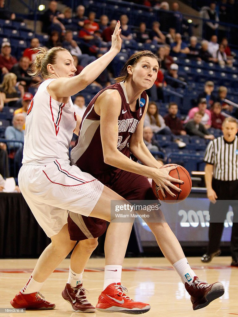 Carly Selvig #24 of the Montana Grizzlies plays against Merritt Hempe #13 of the Georgia Lady Bulldogs during the game at McCarthey Athletic Center on March 23, 2013 in Spokane, Washington. The Lady Bulldogs defeated the Grizzlies 70-50.